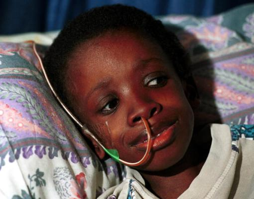 385499 01: FILE PHOTO: Nkosi Johnson, age 12, rests his head on a pillow in his home February 4, 2001 in Melville a suburb in Johannesburg, South Africa. Nkosi, who was the oldest surviving AIDS orphan in South Africa and a National icon in this country''s struggle against the AIDS epidemic, died June 1, 2001 at his family home. He was adopted by Gail Johnson, a white South African woman, 9 years ago after his birth mother died of AIDS and left him in an orphanage. (Photo by Per-Anders Pettersson/Getty Images)