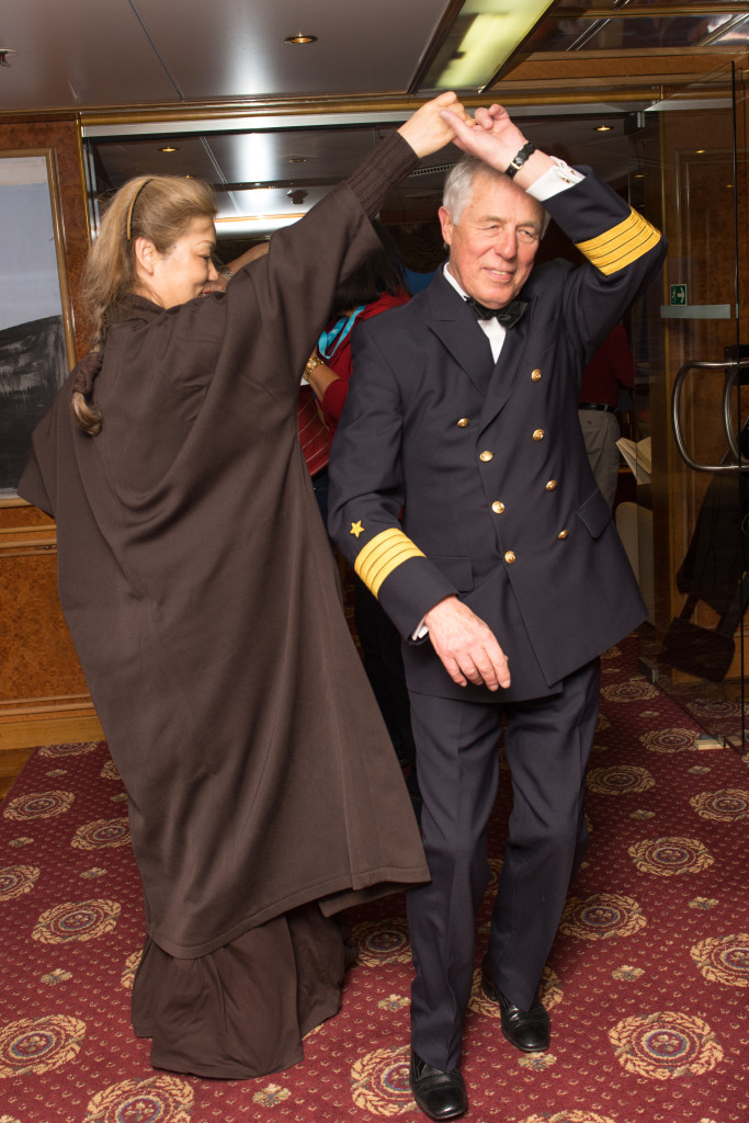 The captain, dancing with a woman from the Chinese tour group