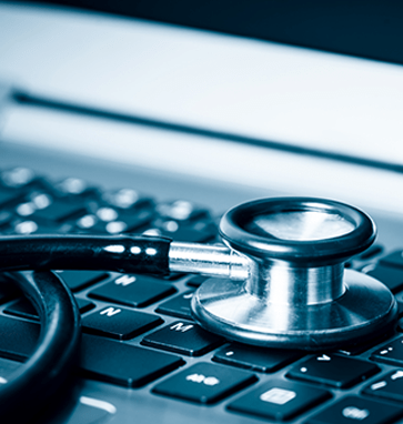 An image of a stethoscope on a computer keyboard