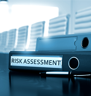 An image of a binder with Risk Assessment written on its spine