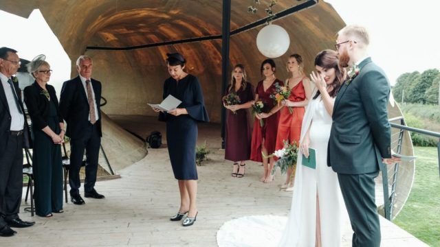Jaems and Libby's unplugged ceremony at an art gallery