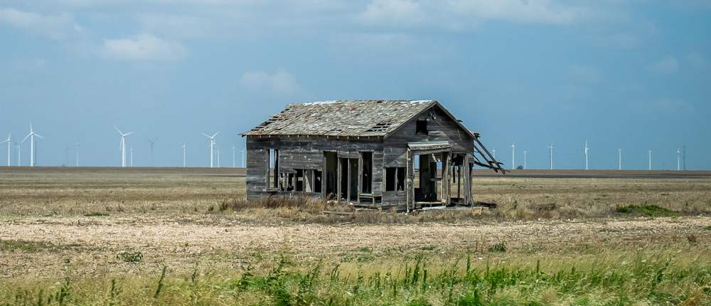 Abandoned House Windmills Behind