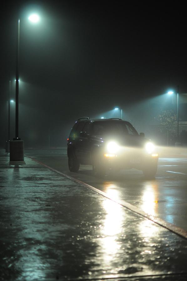 Dark Car In Urban Fog Night Lights Creepy