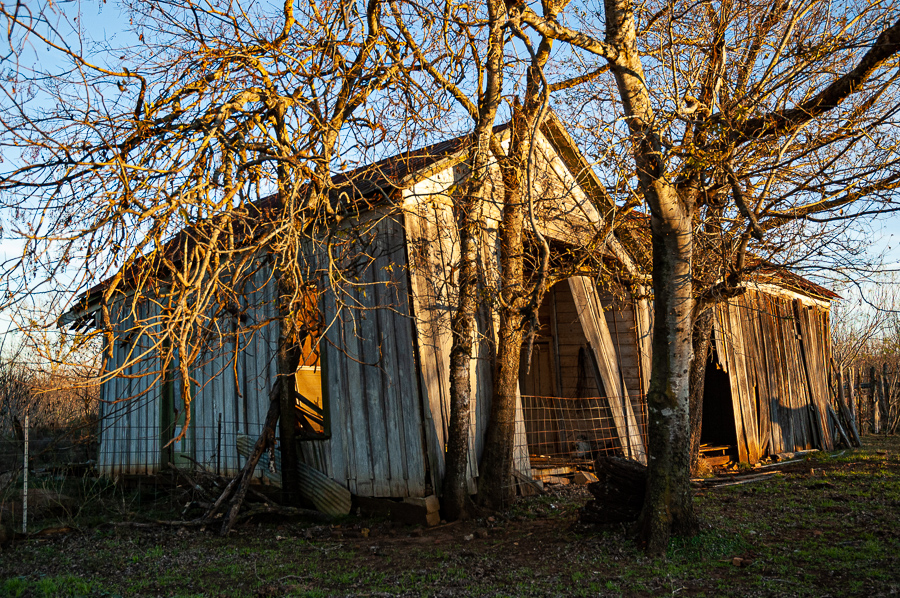Abandoned Building - Barn Glowing In Twilight