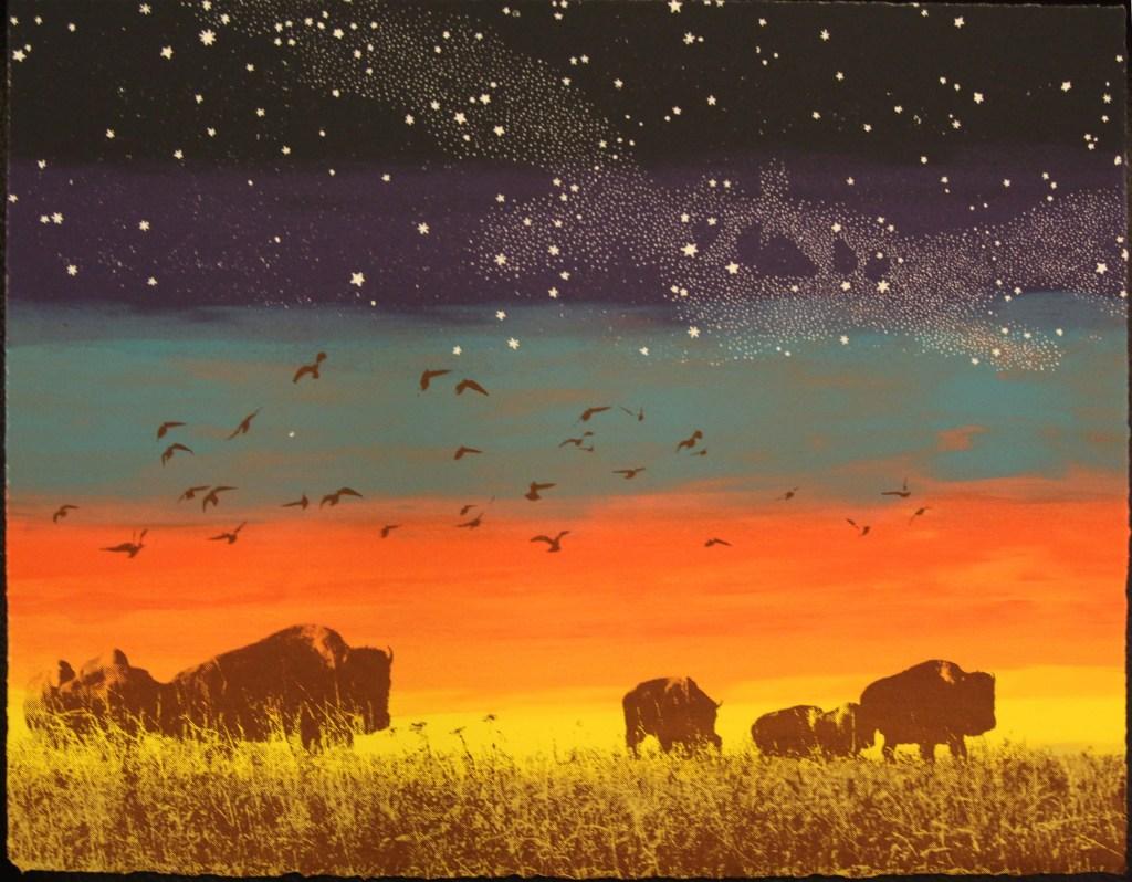 Fiery sunset over buffalo grazing the Kansas prairie.