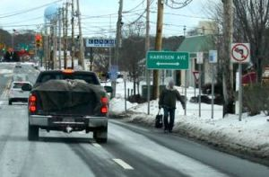 A man walks in the road along Route 58 last month. (RiverheadLOCAL file photo by Peter Blasl)