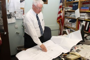 Justice Allen Smith reviews armory building construction plans in his office Monday afternoon. (RiverheadLOCAL photo by Denise Civilettti)