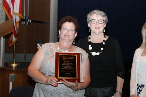 Eileen Rausch, senior clerk typist, 25 years of service.