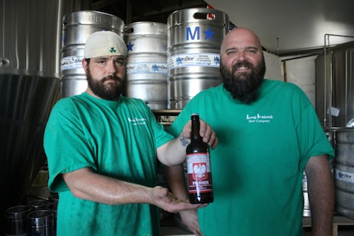 Fred Keller (left) and Dan Burke with one of only 300 bottles of their Polish Town Pilsner. (Photo: Peter Blasl)