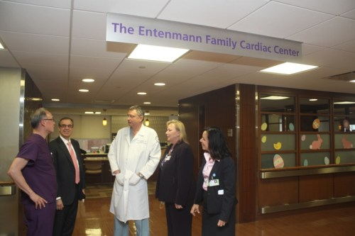 Dr. Larry Ong, left, head of North Shore-LIJ's cardiac catheterization, speaks with chief operating officer Mark Solazzo, chairman of cardiovascular and thoracic surgery Alan Hartman, Winnie Mack, eastern region excutive director WInnie Mack and Southside Hospital executive director Donna Moravick at Southside Hospital's Entenmann Family Cardiac Center on April 3. Photo: Peter Blasl