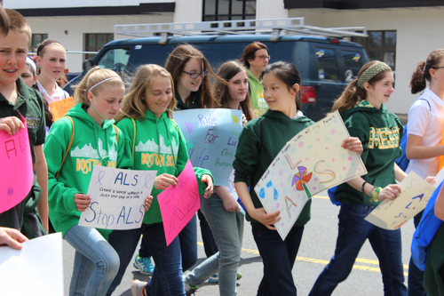 McGann-Mercy students marched down Route 58 this morning as part of the annual cross-island Ride for Life. Photo: Katie Blasl