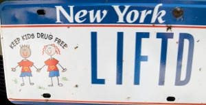 "Gomez's vanity plate bears the street slang for ""getting high"" alongside a ""Keep Kids Drug Free"" picture. Photo: Suffolk County District Attorney's Office"