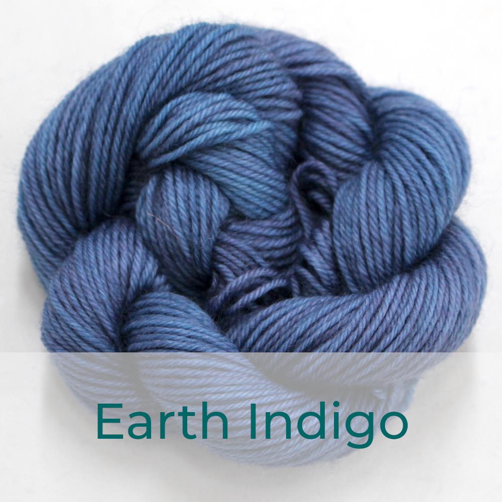 BFL 4 Ply mini skein in the Earth Indigo colourway. It is a soft denim blue.