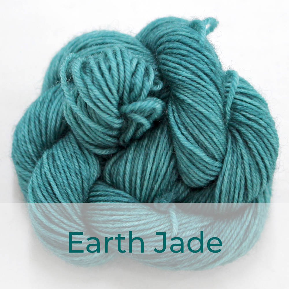 BFL 4 Ply mini skein in the Earth Jade colourway. It is soft sea green.