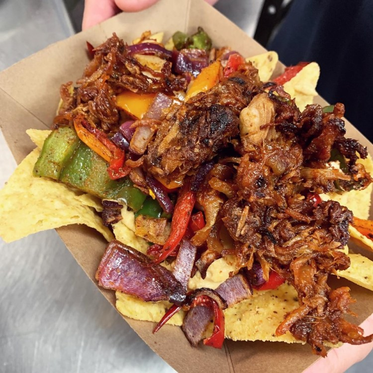 "Spicy ""chorizo"" nachos from plant-based vegan menu at Kind Food KC."