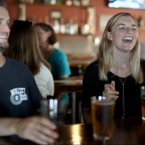 Couple having a drink with friends at Calibration Brewing