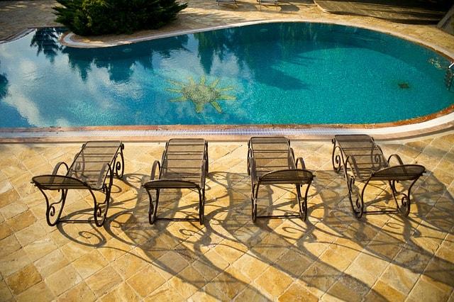 https www riverpoolsandspas com blog pool patio furniture outdoor living spaces guide
