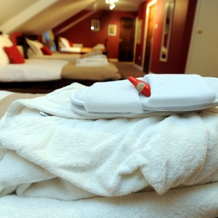 Complimentary fluffy robes, towels and slippers
