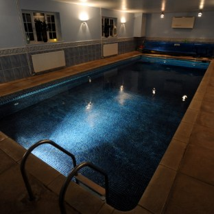 The indoor heated pool at night