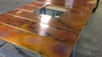 Burnished copper wall panels for fireplace surround