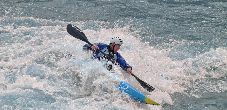 Image of Man in Whitewater Kayak at RIVERSPORT Rapids