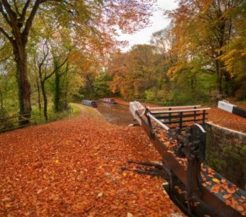 """alt=""""An autumn view of the Brecon to Monmouth Canal at Llangynidr, Brecon Beacons National Park, Wales, United Kingdom"""""""