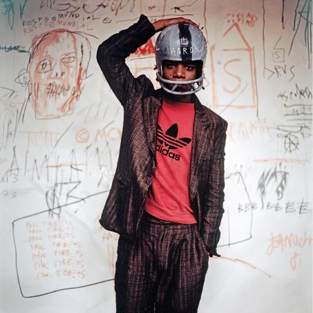 Edo Beroglio, Jean-MIchel Basquiat wearing an American football helmet, © The Estate of Jean - Michel Basquiat, Licensed by Artestar, New York