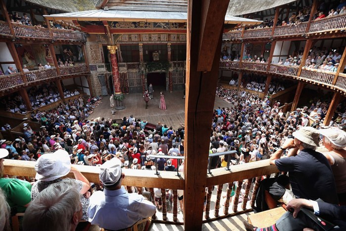 Theatregoers Enjoy The Sunshine During A Performance At The Globe