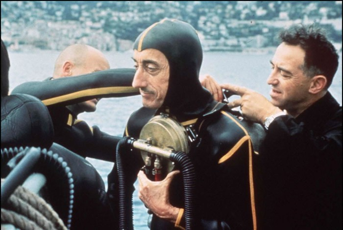Oceanographer Jacques Yves Cousteau, adjusts his diving gear
