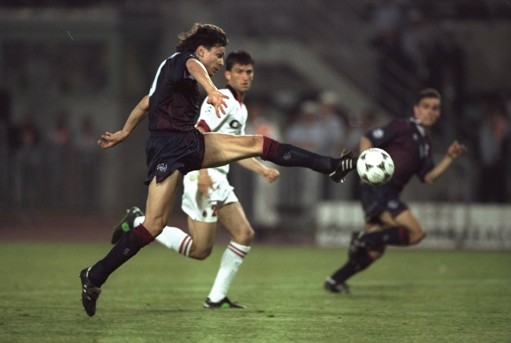 24 May 1995: Jari Litmanen (left) of Ajax blocks the ball from Claudio Panucci (centre) of AC Milan during the European Cup Final in Vienna, Austria. Ajax won the match 1-0. Mandatory Credit: Clive Brunskill/Allsport