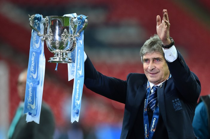 TOPSHOT - Manchester City's Chilean manager Manuel Pellegrini holds up the League cup after the presentation after City won the English League Cup final football match between Liverpool and Manchester City at Wembley Stadium in London on February 28, 2016. / AFP / BEN STANSALL / RESTRICTED TO EDITORIAL USE. No use with unauthorized audio, video, data, fixture lists, club/league logos or 'live' services. Online in-match use limited to 75 images, no video emulation. No use in betting, games or single club/league/player publications. / (Photo credit should read BEN STANSALL/AFP/Getty Images)