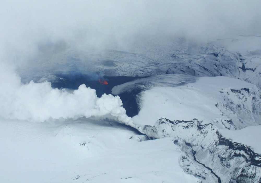 Lava spews out of a mountain on March 21