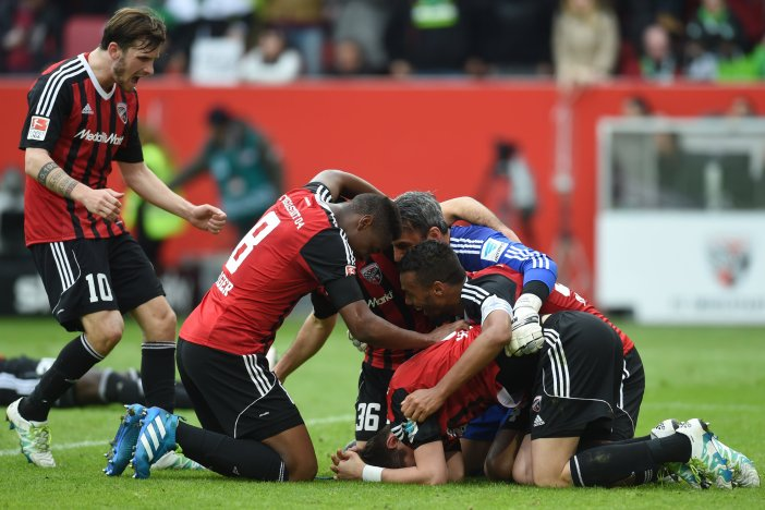 Several Ingolstadt players celebrate during the German Bundesliga first division football match between FC Ingolstadt 04 and Borussia Moenchengladbach in Ingolstadt, Germany , on April 9, 2016. / AFP / CHRISTOF STACHE / RESTRICTIONS: DURING MATCH TIME: DFL RULES TO LIMIT THE ONLINE USAGE TO 15 PICTURES PER MATCH AND FORBID IMAGE SEQUENCES TO SIMULATE VIDEO. == RESTRICTED TO EDITORIAL USE == FOR FURTHER QUERIES PLEASE CONTACT DFL DIRECTLY AT + 49 69 650050 (Photo credit should read CHRISTOF STACHE/AFP/Getty Images)