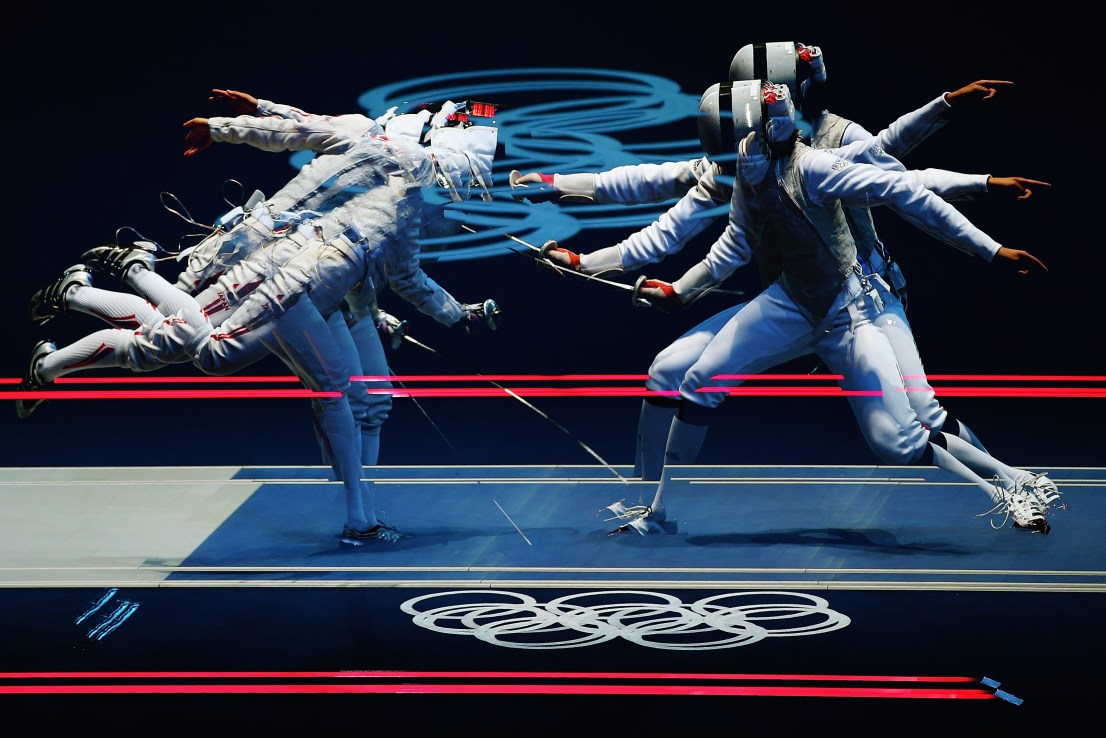 LONDON, ENGLAND - JULY 28: (EDITORS NOTE: Multiple exposures were combined in camera to produce this image.) Carolin Golubytskyi of Germany competes against Elisa Di Francisca of Italy in their Women's Foil Individual Fencing round of 16 match on Day 1 of the London 2012 Olympic Games at ExCeL on July 28, 2012 in London, England. (Photo by Hannah Peters/Getty Images)