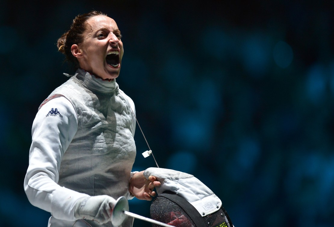 Italy's Elisa Di Francisca celebrates her victory over Italy's Arianna Errigo at the end of their women's foil gold medal fencing bout as part of the London 2012 Olympic games, on July 28, 2012 at the ExCel centre in London. AFP PHOTO / ALBERTO PIZZOLI (Photo credit should read ALBERTO PIZZOLI/AFP/GettyImages)