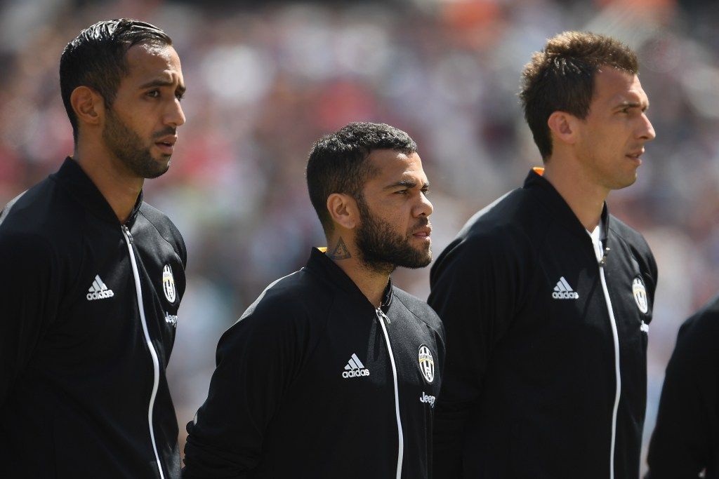 LONDON, ENGLAND - AUGUST 07: Former Barcelona player Dani Alves lines up with his new Juventus team mates ahead of the Pre-Season Friendly between West Ham United and Juventus at London Stadium on August 7, 2016 in London, England. (Photo by Mike Hewitt/Getty Images)