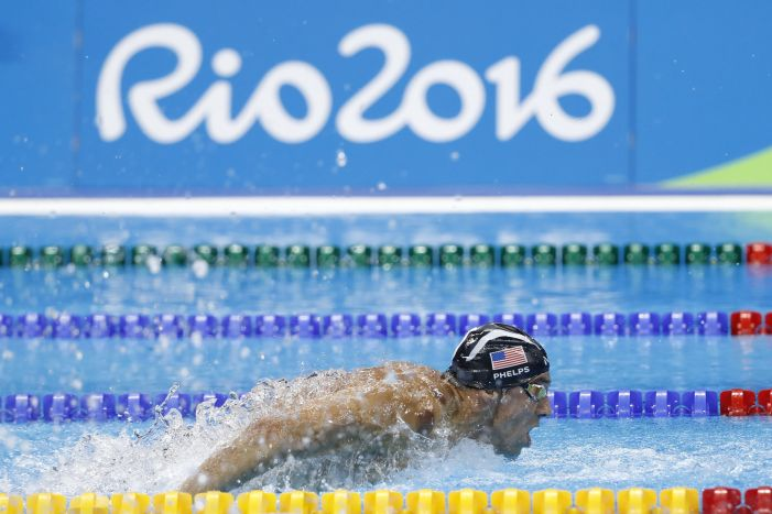 TOPSHOT - USA's Michael Phelps competes in the Men's 200m Butterfly Semifinal during the swimming event at the Rio 2016 Olympic Games at the Olympic Aquatics Stadium in Rio de Janeiro on August 8, 2016. / AFP / Odd Andersen (Photo credit should read ODD ANDERSEN/AFP/Getty Images)