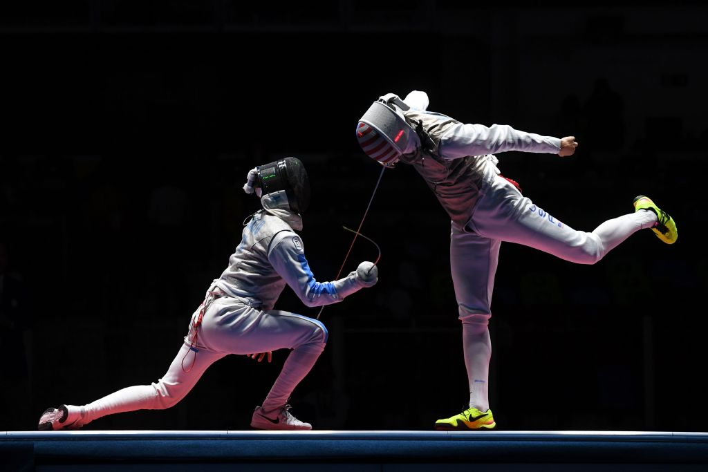 Italy's Daniele Garozzo (L) competes against US Alexander Massialas during the mens team foil bronze medal bout between Italy and US as part of the fencing event of the Rio 2016 Olympic Games, on August 12, 2016, at the Carioca Arena 3, in Rio de Janeiro. / AFP / Kirill KUDRYAVTSEV (Photo credit should read KIRILL KUDRYAVTSEV/AFP/Getty Images)