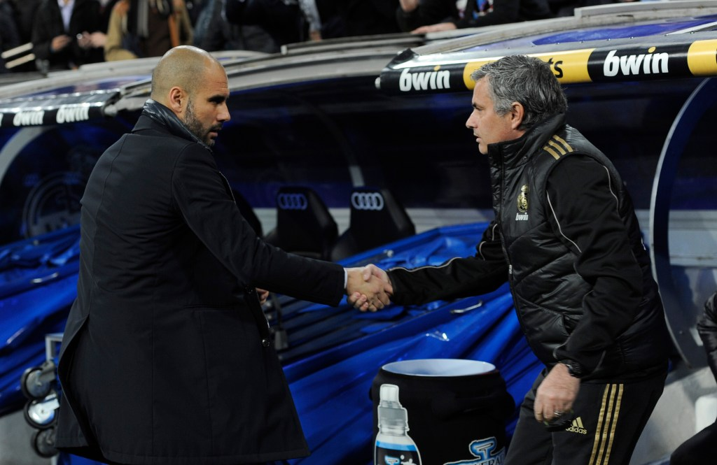 "Barcelona's coach Josep Guardiola (L) and Real Madrid's coach Jose Mourinho shake hand before the Spanish Cup ""El clasico"" football match Real Madrid vs Barcelona at the Santiago Bernabeu stadium in Madrid on January 18, 2011. AFP PHOTO/ DANI POZO (Photo credit should read DANI POZO/AFP/Getty Images)"