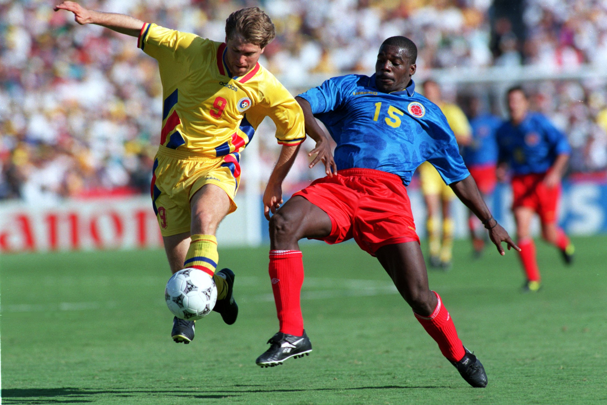 18 JUN 1994: FLORIN VALERIU RADUCIOIU OF ROMANIA, LEFT, AND LUIS CARLOS PEREA OF COLOMBIA IN ACTION DURING THE COLOMBIA V ROMANIA MATCH AT THE ROSE BOWL IN LOS ANGELES, CALIFORNIA. Mandatory Credit: Shaun Botterill/ALLSPORT