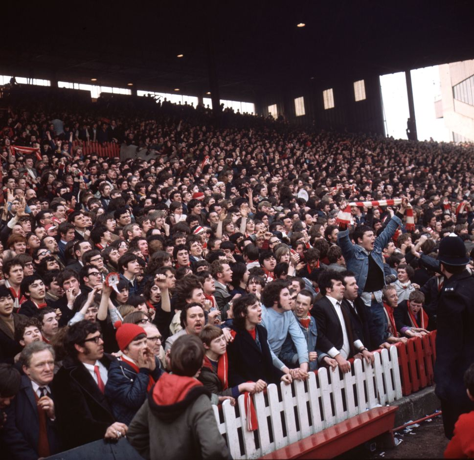 1971: Supporters of Liverpool FC on the terraces during a semi-final match against Everton in the FA cup. (Photo by Aubrey Hart/Express/Getty Images)