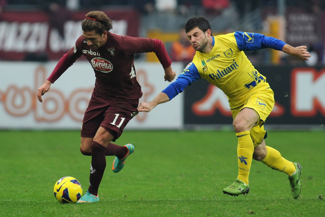 TURIN, ITALY - DECEMBER 22: Alessio Cerci (L) of Torino FC is challenged by Bojan Jokic of AC Chievo Verona during the Serie A match between Torino FC and AC Chievo Verona at Stadio Olimpico di Torino on December 22, 2012 in Turin, Italy. (Photo by Valerio Pennicino/Getty Images)