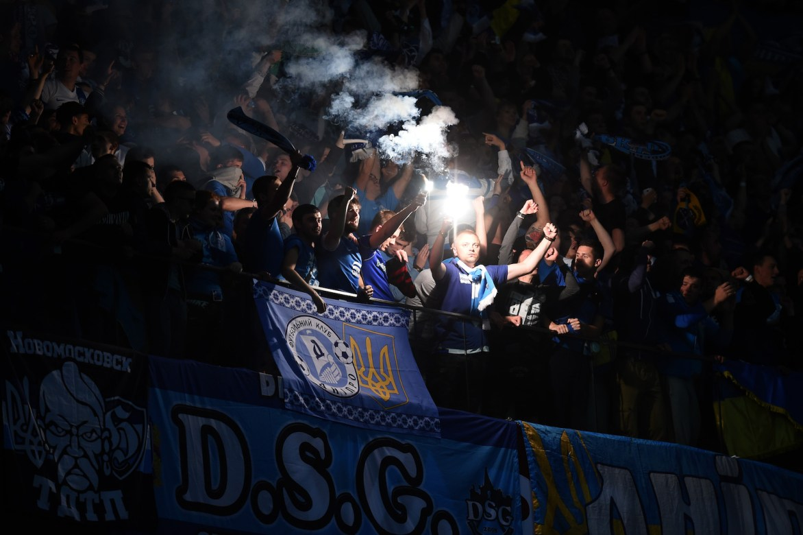 WARSAW, POLAND - MAY 27: Dnipro fans light flares during the UEFA Europa League Final match between FC Dnipro Dnipropetrovsk and FC Sevilla on May 27, 2015 in Warsaw, Poland. (Photo by Michael Regan/Getty Images)