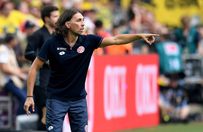 Mainz' Swiss head coach Martin Schmidt reacts during the German first division Bundesliga football match of Borussia Dortmund vs FSV Mainz 05 in Dortmund, western Germany, on August 27, 2016. / AFP / PATRIK STOLLARZ / RESTRICTIONS: DURING MATCH TIME: DFL RULES TO LIMIT THE ONLINE USAGE TO 15 PICTURES PER MATCH AND FORBID IMAGE SEQUENCES TO SIMULATE VIDEO. == RESTRICTED TO EDITORIAL USE == FOR FURTHER QUERIES PLEASE CONTACT DFL DIRECTLY AT + 49 69 650050 (Photo credit should read PATRIK STOLLARZ/AFP/Getty Images)