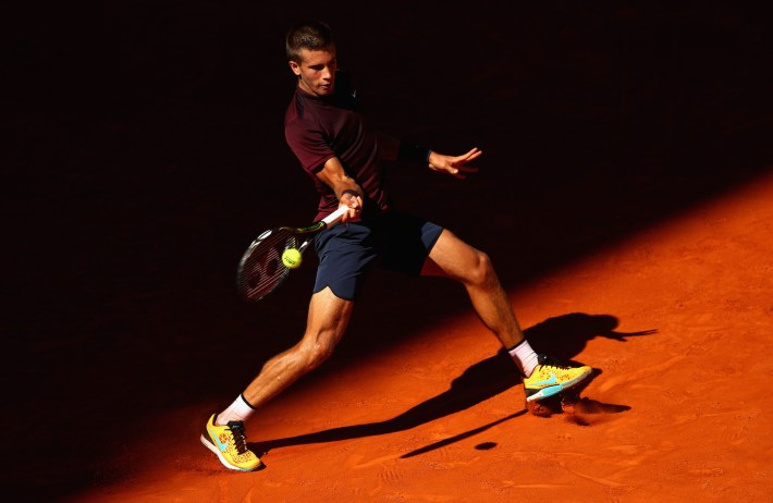 MADRID, SPAIN - MAY 04: Borna Coric of Croatia plays a forehand against Novak Djokovic of Serbia in their second round match during day five of the Mutua Madrid Open tennis tournament at the Caja Magica on May 04, 2016 in Madrid. (Photo by Clive Brunskill/Getty Images)