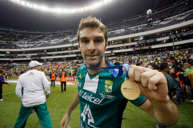 Mauro Boselli of Leon celebrates at the Azteca stadium after Leon defeated America in the final of the Mexican Apertura tournament in Mexico City on December 15, 2013. AFP PHOTO/Hector Guerrero (Photo credit should read HECTOR GUERRERO/AFP/Getty Images)