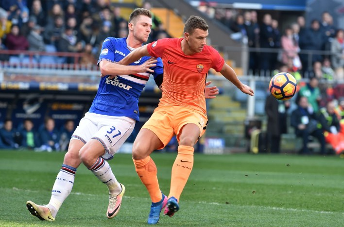 GENOA, ITALY - JANUARY 29: Edin Dzeko (Roma) and Milan Skriniar (Sampdoria) during the Serie A match between UC Sampdoria and AS Roma at Stadio Luigi Ferraris on January 29, 2017 in Genoa, Italy. (Photo by Paolo Rattini/Getty Images)