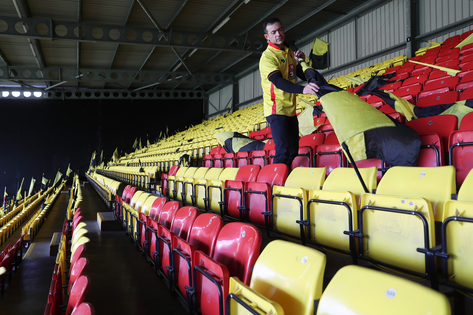 WATFORD, ENGLAND - APRIL 01: A Watford fan prepares a flag prior to the Premier League match between Watford and Sunderland at Vicarage Road on April 1, 2017 in Watford, England. (Photo by Christopher Lee/Getty Images)