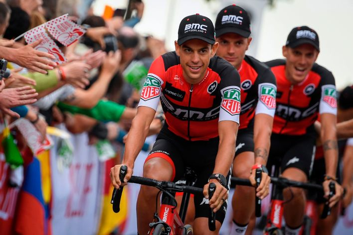 Australia's Richie Porte (L) and his teammates parade during the team presentation ceremony in Dusseldorf, Germany, on June 29, 2017, two days before the start of the 104th edition of the Tour de France cycling race. The 2017 Tour de France will start on July 1 in the streets of Dusseldorf and ends on July 23, 2017 down the Champs-Elysees in Paris. / AFP PHOTO / Lionel BONAVENTURE (Photo credit should read LIONEL BONAVENTURE/AFP/Getty Images)