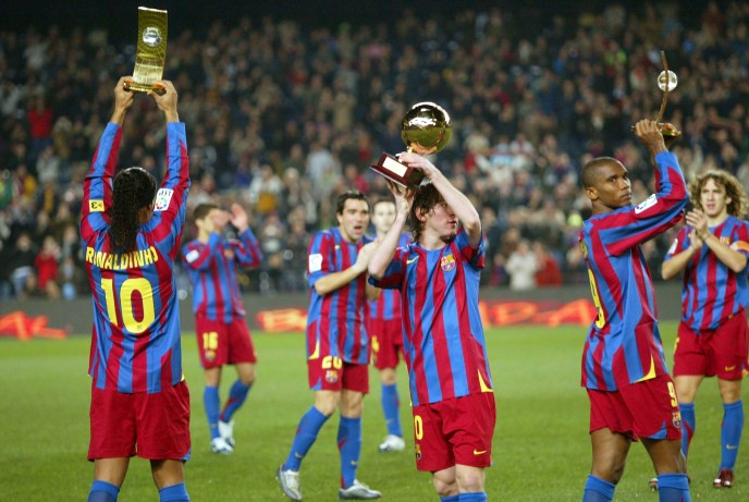 BARCELONA, SPAIN - DECEMBER 20: FIFA World player of the year winner Ronaldinho, the Gillette Best Young Player Award Leo Messi, and third place FIFA World player of the year Samuel Etoo pose with their trophies before La Liga match between FC Barcelona and Celta, at the Camp Nou stadium December 20, 2005 in Barcelona, Spain. (Photo by Luis Bagu/Getty Images)